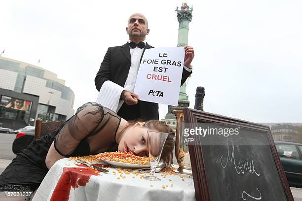 Members of People for the Ethical Treatment of Animals hold a happening on December 5 2012on Bastille square in Paris to denounce the forcefeeding...
