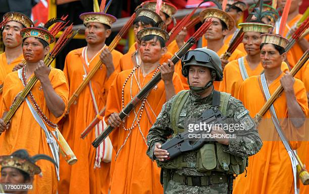 Members of Peru's Committees of Self Defense march during a traditional military parade in Lima on July 29 commemorating the country's 192nd...