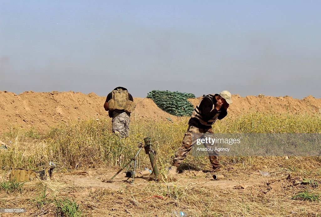 Members of Peshmerga forces and Shiite Hasdi Sabi forces attack Daesh with howitzers to rescue Turkmen Besir Village from Daesh in Kirkuk, Iraq on April 30, 2016.