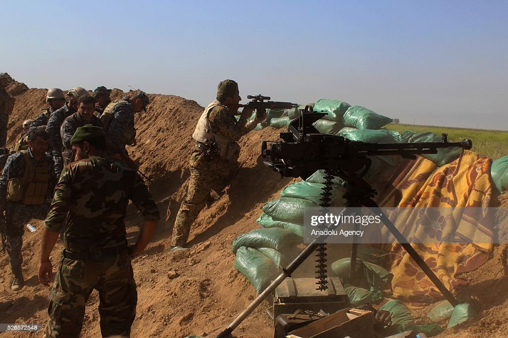 Members of Peshmerga forces and Shiite Hasdi Sabi forces attack Daesh with machine gun to rescue Turkmen Besir Village from Daesh in Kirkuk, Iraq on April 30, 2016.