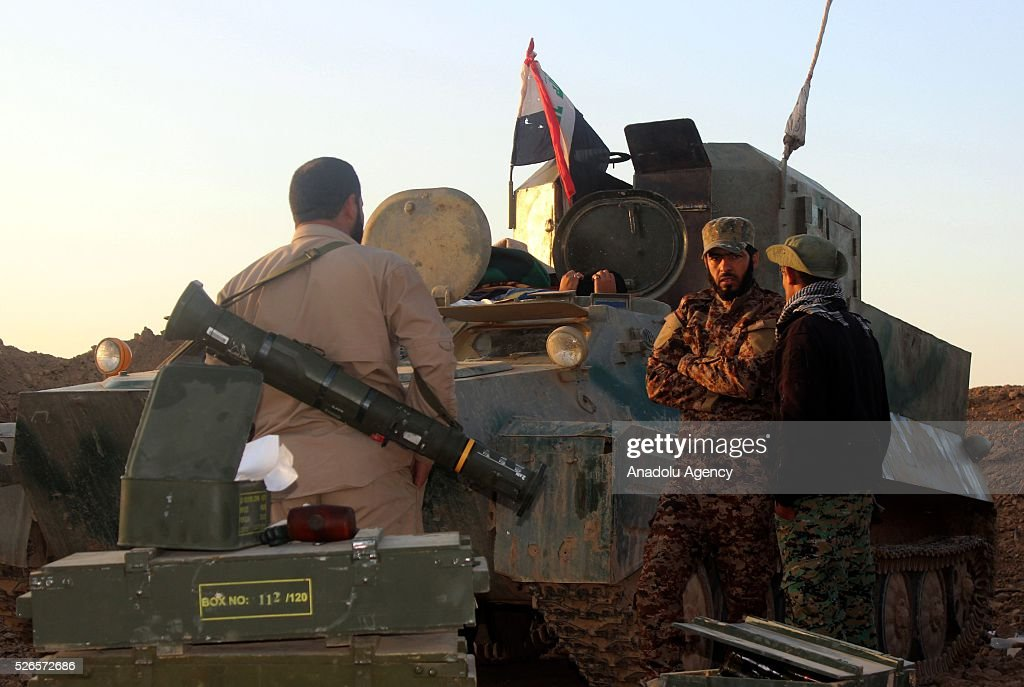 Members of Peshmerga forces and Shiite Hasdi Sabi forces attack Daesh with armoured vehicles to rescue Turkmen Besir Village from Daesh in Kirkuk, Iraq on April 30, 2016.