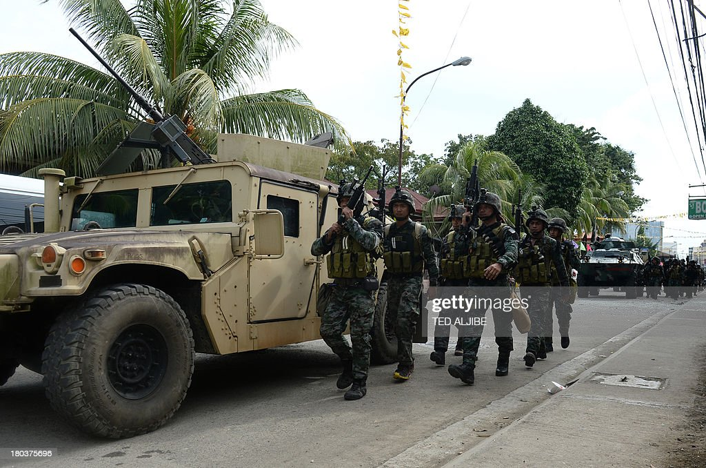 Members of Philippine national police special forces arrive to reinforce soldiers during a fire fight between government forces and Muslim rebels as...
