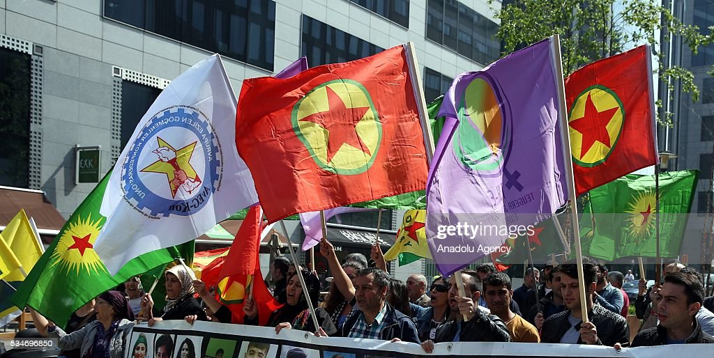 Members of PKK terrorist organization stage a protest against Turkey with Belgium's permit at Schuman Square in Brussels, Belgium on May 27, 2016.