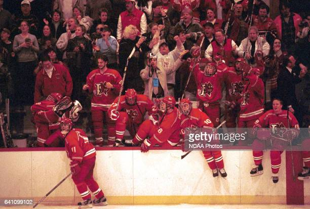 Members of Plattsburg State University clear the bench in celebration at the end of the game following the 2001 NCAA Men's Ice Hockey Championship...