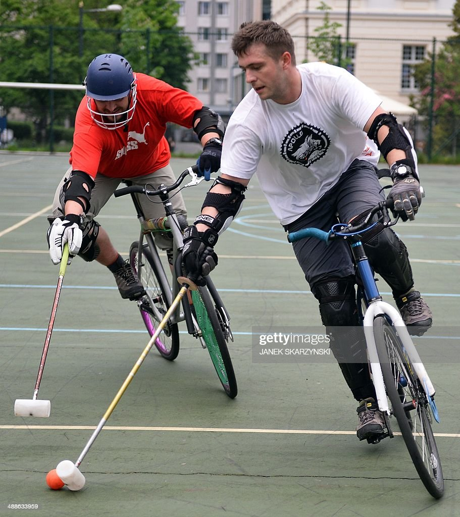 Members of Polish Hardcourt Bike Polo Association train on a school pitch in Warsaw on May 7, 2014. Cycle polo is a team sport, similar to traditional polo, except that bicycles are used instead of horses.