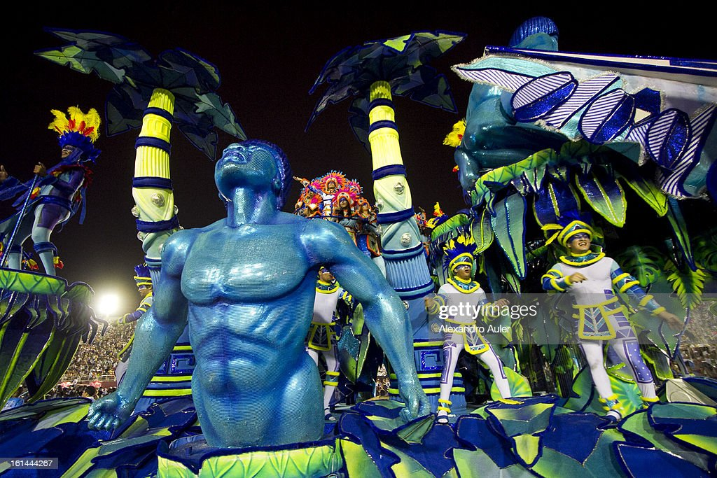 Members of Portela Samba School parade at 2013 Brazilian Carnival at Sapucaí Smbodrome on February 11; 2013 in Rio de Janeiro; Brazil. Rio's two nights of Carnival parades began on February 10 in a burst of fireworks and to the cheers of thousands of turists and locals who have previously enjoyed Street celebrations (known as Blocos de rua) all around the city.