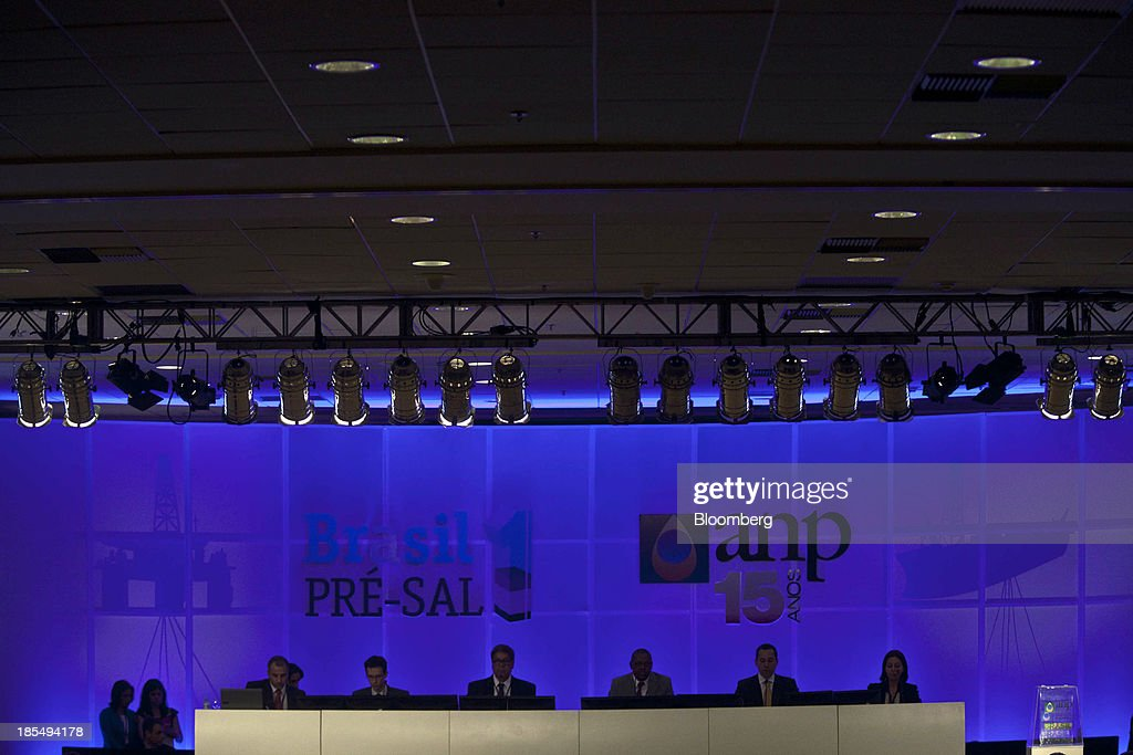 Members of Pre-Sal Petroleo, known as the PPSA, the state-run company created to manage the development of Brazil's pre-salt oilfields, wait for bids to be delivered during an auction in Rio de Janeiro, Brazil, on Monday, Oct. 21, 2013. A group led by Petroleo Brasileiro SA won a license to develop Brazils biggest oil discovery under more favorable terms than analysts estimated. Shares in Petrobras, as the state-run producer is known, surged. Photographer: Dado Galdieri/Bloomberg via Getty Images