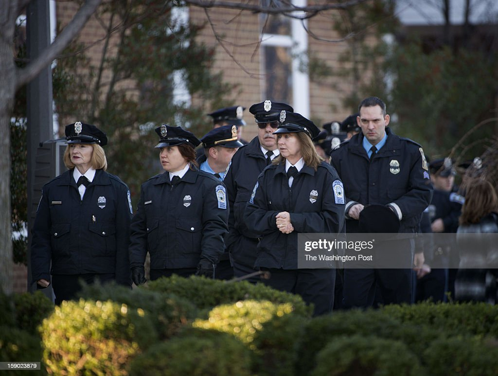 Members of Prince William County Parking Enforcement and Police Department arrive at Hylton Memorial Chapel for the funeral service of Prince William County Police Officer Chris Yung on Friday, January 4, 2013.