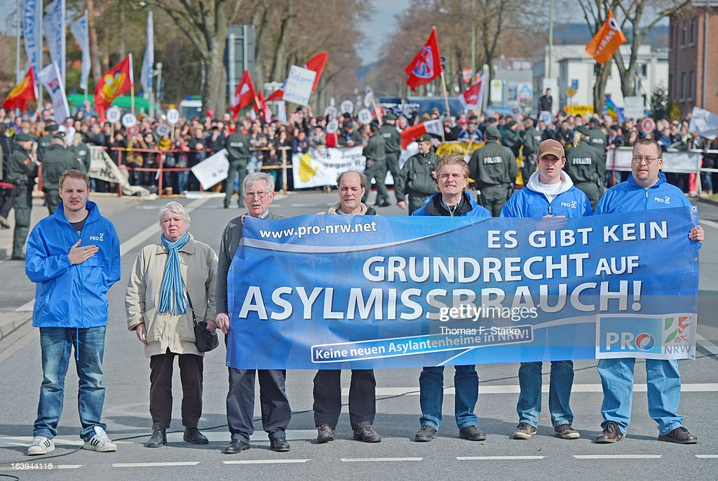 Members of Pro-NRW line up after a protester hit Joerg Ueckermann, Deputy Chairman of the anti-Islam Pro-NRW group, in the face with an egg while Ueckermann was speaking during a Pro-NRW rally on March 18, 2013 in Bielefeld, Germany. Nine Pro-NRW members held the rally and were booed down by 700 counter-demonstrators. Pro-NRW, based primarily in western Germany and Berlin, has sought a strongly anti-Islam agenda and demonstrates frequently against the construction of mosques in Germany. Police recently arrested several radical Salafite Islam members in Germany who were planning to assassinate Pro-NRW leader Markus Beisicht.