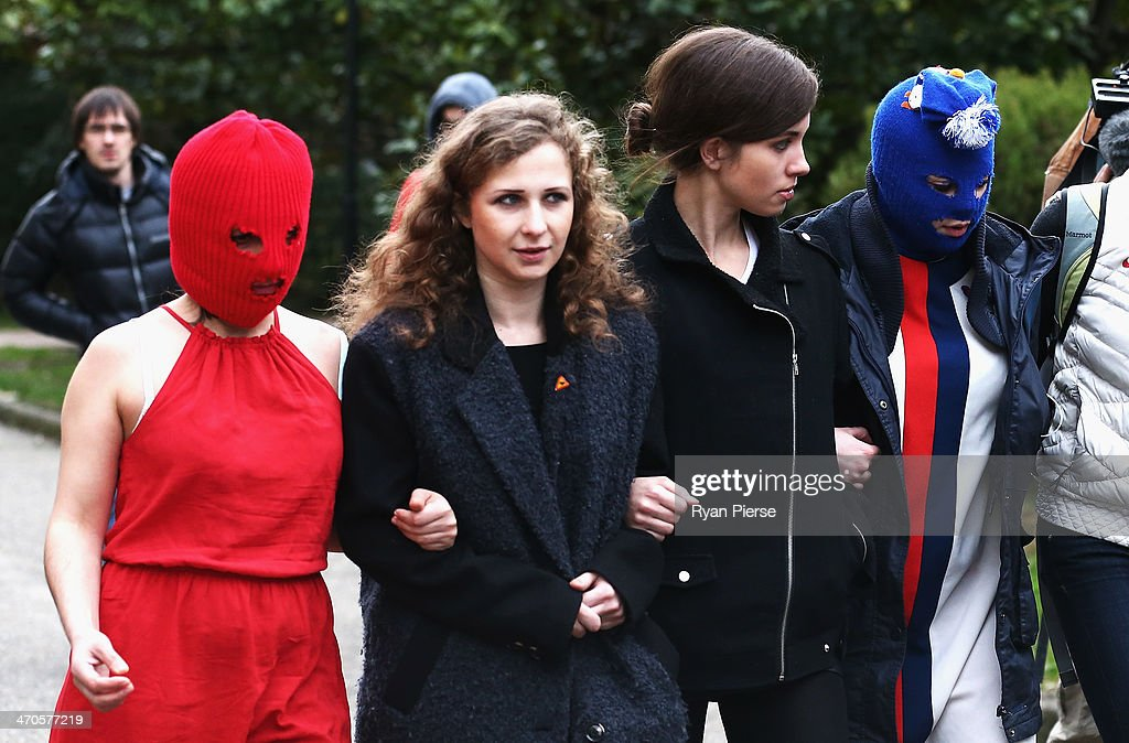 Members of protest group Pussy Riot arrive for a press conference on February 20, 2014 in Sochi, Russia.