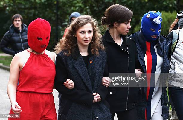 Members of protest group Pussy Riot arrive for a press conference on February 20 2014 in Sochi Russia