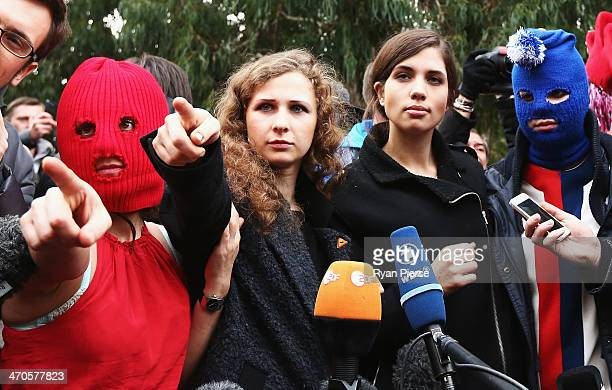 Members of protest group Pussy Riot speak during a press conference on February 20 2014 in Sochi Russia