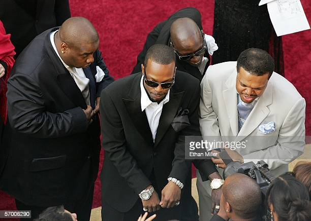 Members of rap group Three 6 Mafia Project Pat Juicy J Crunchy Black and DJ Paul are interviewed as they arrive at the 78th Annual Academy Awards at...