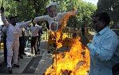 Members of Rashtriya Dalit Sahitya Akadmi burn effigy of Samajwadi Party Chief Mulayam Singh Yadav and Uttar Pradesh Chief Minister Akhilesh Yadav...