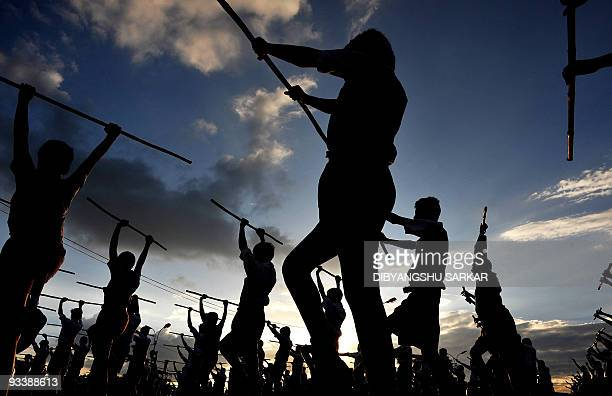 Members of Rashtriya Swayamsevak Sangh National Volunteers Organisation take part in a physical drill during a public meeting in Bangalore on...