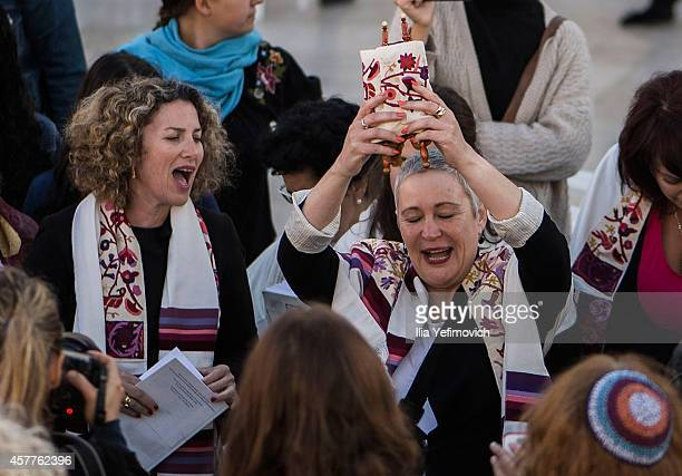 Members of rights group 'Women of the Wall' succeed for the first time in smuggling a Torah scroll to the Western Wall on October 24 2014 in...