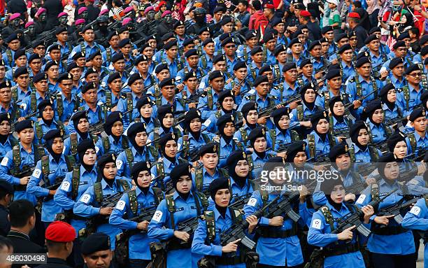 Members of Royal Malaysian Navy march during the celebrations of 58th National Day at Merdeka Square on August 31 2015 in Kuala Lumpur Malaysia...