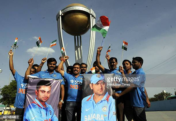 Members of Rudraksh Organisation perform an yagna for success of Indian cricket team in front of where a replica of World Cup put by Indore...