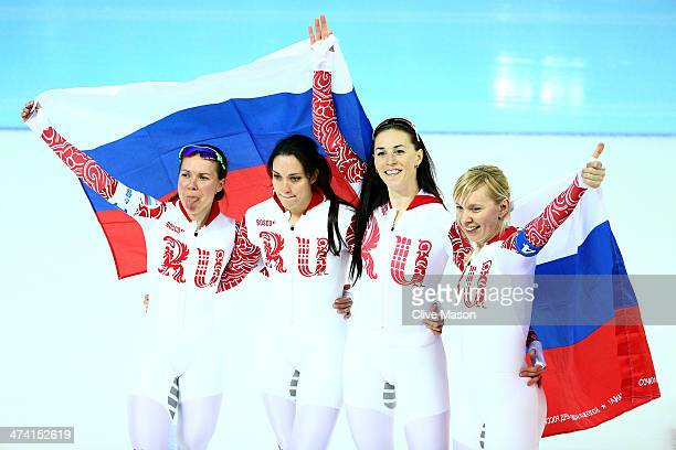 Members of Russia celebrate winning the bronze medal during the Women's Team Pursuit Final B Speed Skating event on day fifteen of the Sochi 2014...