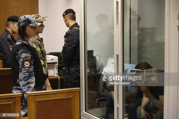 Members of Russian 'Grand Theft Auto gang' are seen at the court hearing at Moscow Regional Court in Krasnogorsk August 8 2017 outside Moscow Russia...