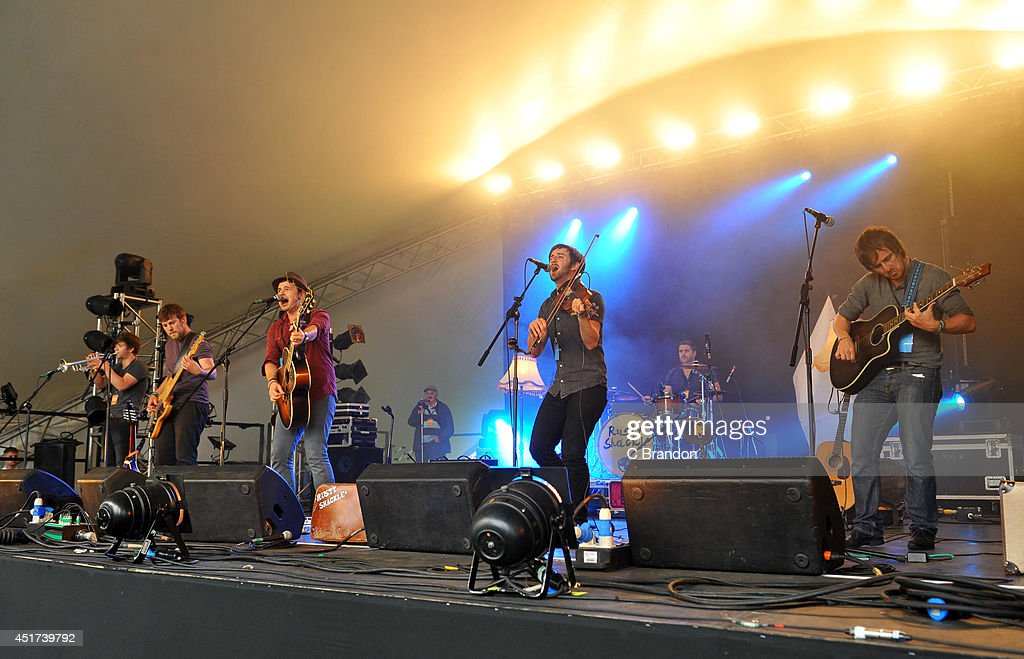 . members of Rusty Shackle perform on stage at the Cornbury Music Festival at Great Tew Estate on July 5, 2014 in Oxford, United Kingdom.