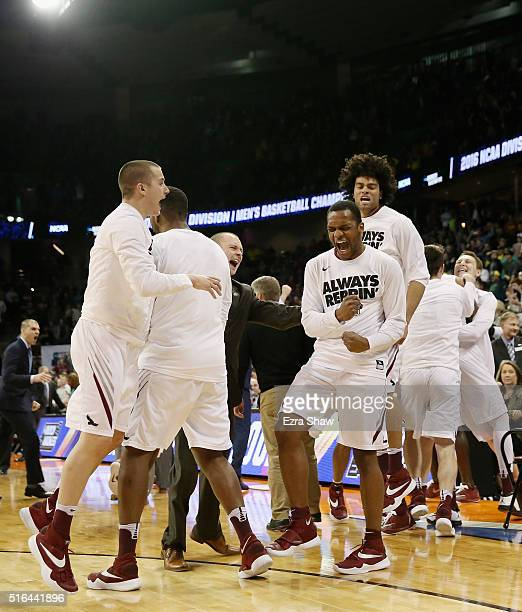 Members of Saint Joseph's Hawks celebrate their 7876 win over the Cincinnati Bearcats during the first round of the 2016 NCAA Men's Basketball...