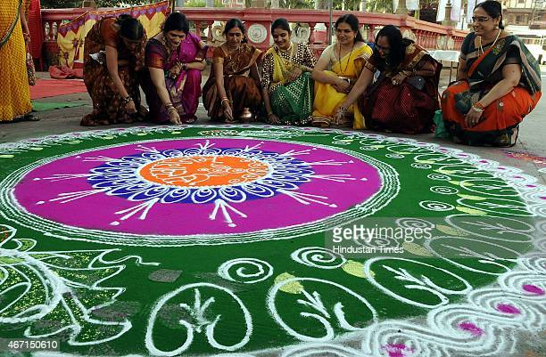 Members of Sanskar Bharti making Rangoli on the occasion of Gudi Padwa at Rajwada on March 21 2015 in Indore India Celebrated on the first day of the...