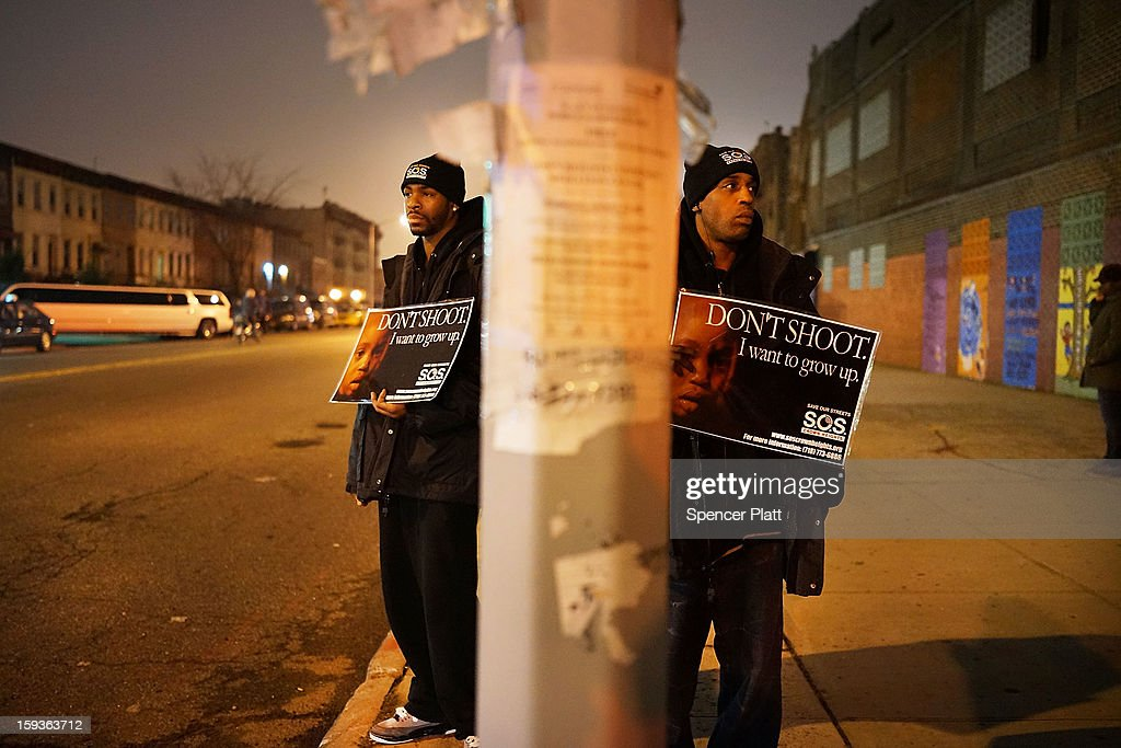 Members of Save Our Streets (S.O.S.) hold a rally and vigil on the sidewalk near where a 16-year-old boy was shot last Tuesday evening, on January 12, 2013 in the Crown Heights neighborhood of the Brooklyn borough of New York City. The gathering was sponsored by the local group S.O.S., which is a community-based effort to end gun violence. S.O.S. holds the gatherings at all shooting locations in Crown Heights to draw attention to the violence and to encourage a community response to the shootings. While murders were down for 2012 in New York City, gun violence continues to plague many communities.