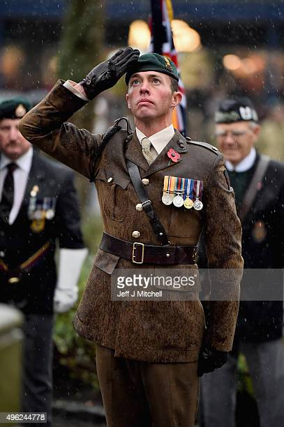 A members of Scotland's armed forces and veterans salutes as he gathers with others to commemorate and pay respect to the sacrifice of service men...
