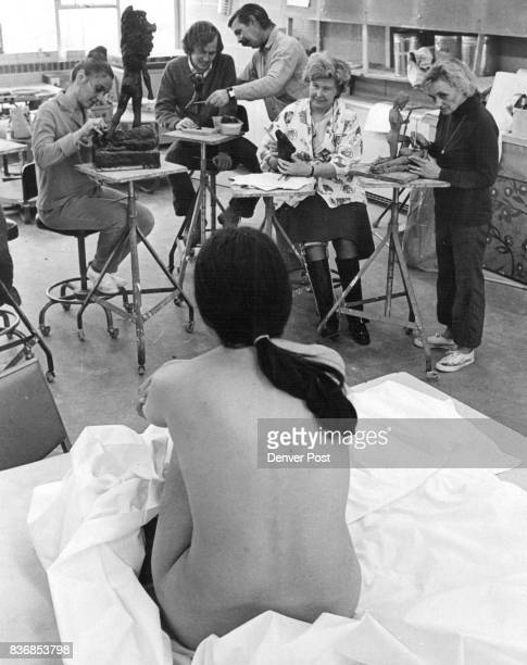 Members of sculpturing class working from nude model are left to right Mrs Carlos Abel Tom Wermers instructor Fritz White Mrs David Talmadge and Mrs...
