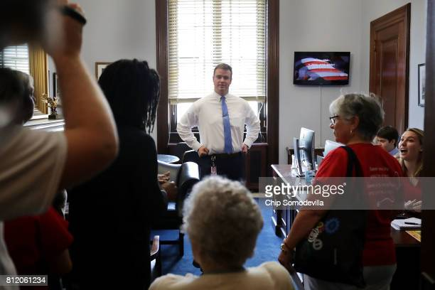 Members of Sen Ted Cruz's staff face down demonstrators from Texas in his office during a protest against health care reform legislation in the...