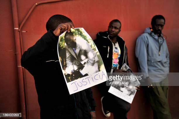 Members of Senegalese community take part in a demonstration in Sant Adria del Besos in Barcelona on January 4 to protest against the death of a...