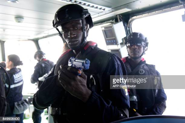 Members of Senegal's marines special forces take part in a mock exercise aboard the 'Casimir' a mock trawler suspected of illegal fishing during a...