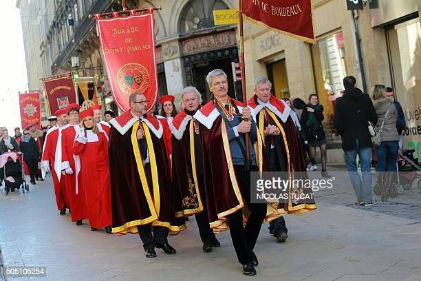 Members of several wine producer brotherhoods from Bordeaux walk in procession with tradionnal costumes and flags to the city hall on January 15 2016...