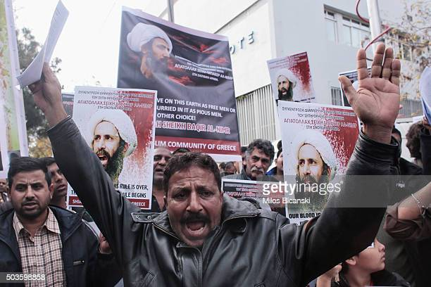 Members of Shia Muslim community of Greece hold posters of Sheikh Nimr alNimr during a protest rally outside of Saudi Arabia's embassy on January 6...