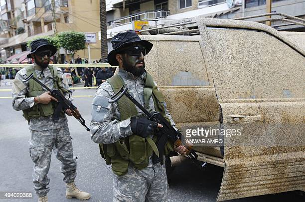 Members of Shiite Hezbollah movement's special forces hold their weapon during a rally marking Ashura on the tenth day of the mourning period of...