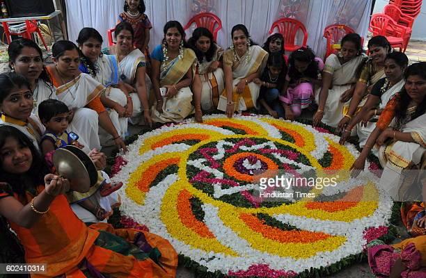 Members of Shyam Nagar Annexe Malayalees Association make AthaPookalam a rangoli made by using flowers of several colours to welcome Bhagwan Mahabali...