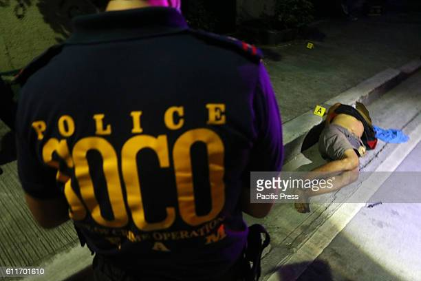 Members of SOCO process the crime scene and the remain of Unidentified allegedly drug dealers are the victims of summary executions at Plorentino St...
