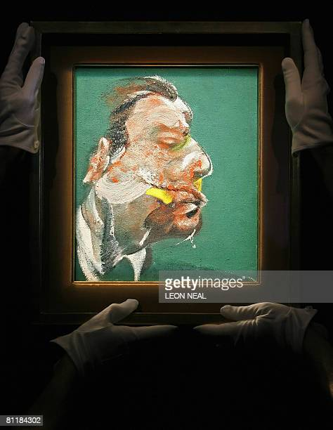 Members of Sotheby's auction house adjusts a painting entitled 'Study for Head of George Dyer' by AngloIrish artist Francis Bacon in central London...