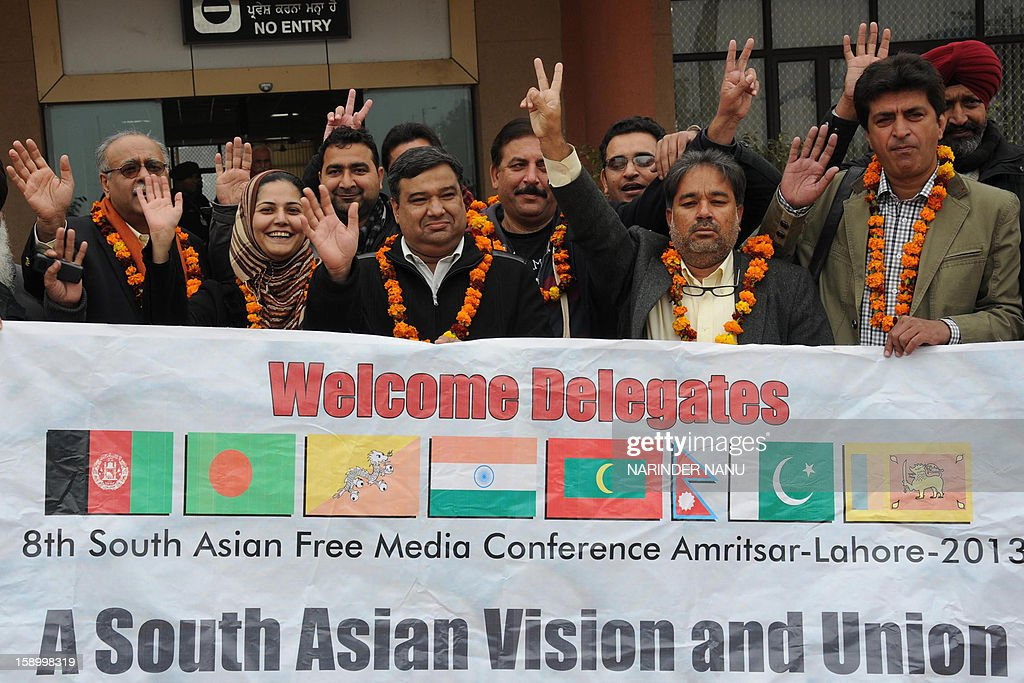 Members of South Asia Free Media Association (SAFMA) from Pakistan arrive at the newly constructed Integrated Check Post (ICP) at the India-Pakistan border in Wagah on January 5,2013 . About 200-member delegates from eight SAARC countries will arrive to take part in the 8th South Asia Free Media Association (SAFMA) International Conference 2013, in Amritsar and Lahore in Pakistan from January 5 to 9.