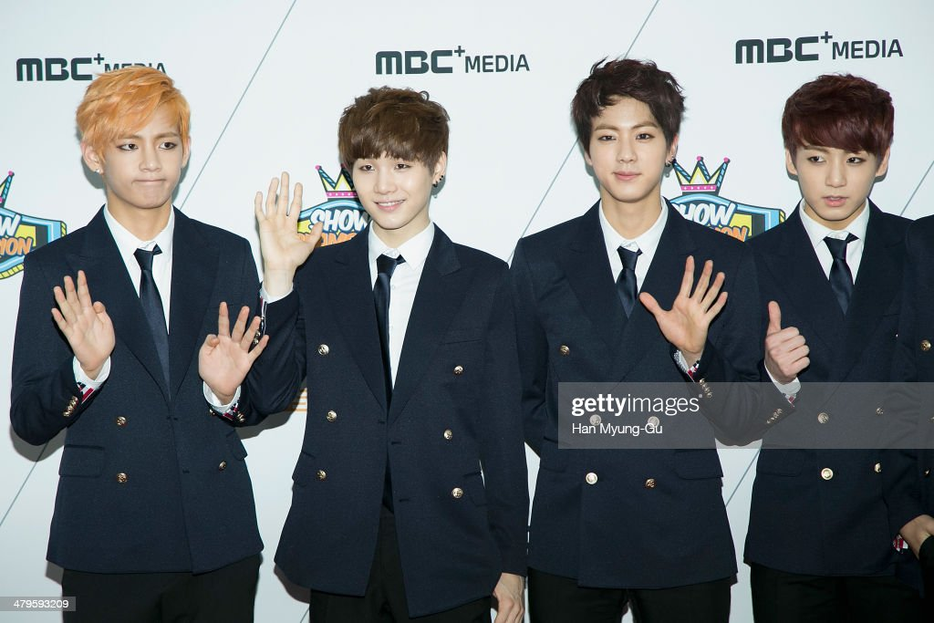 Members of South Korean boy band BTS attend MBC Music 'Show Champion' on March 19, 2014 in Ilsan, South Korea.