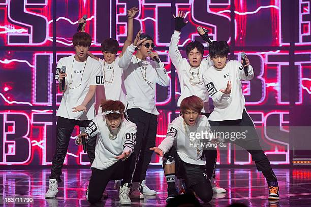 Members of South Korean boy band BTS perform onstage the MBC Music 'Show Champion' at Uniqlo AXHall on October 09 2013 in Seoul South Korea