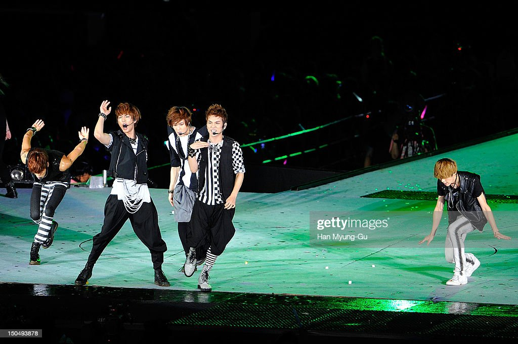 Members of South Korean boy band SHINee and Luhan of boy band EXO-M perform onstage during the SMTown Live World Tour III on August 18, 2012 in Seoul, South Korea.