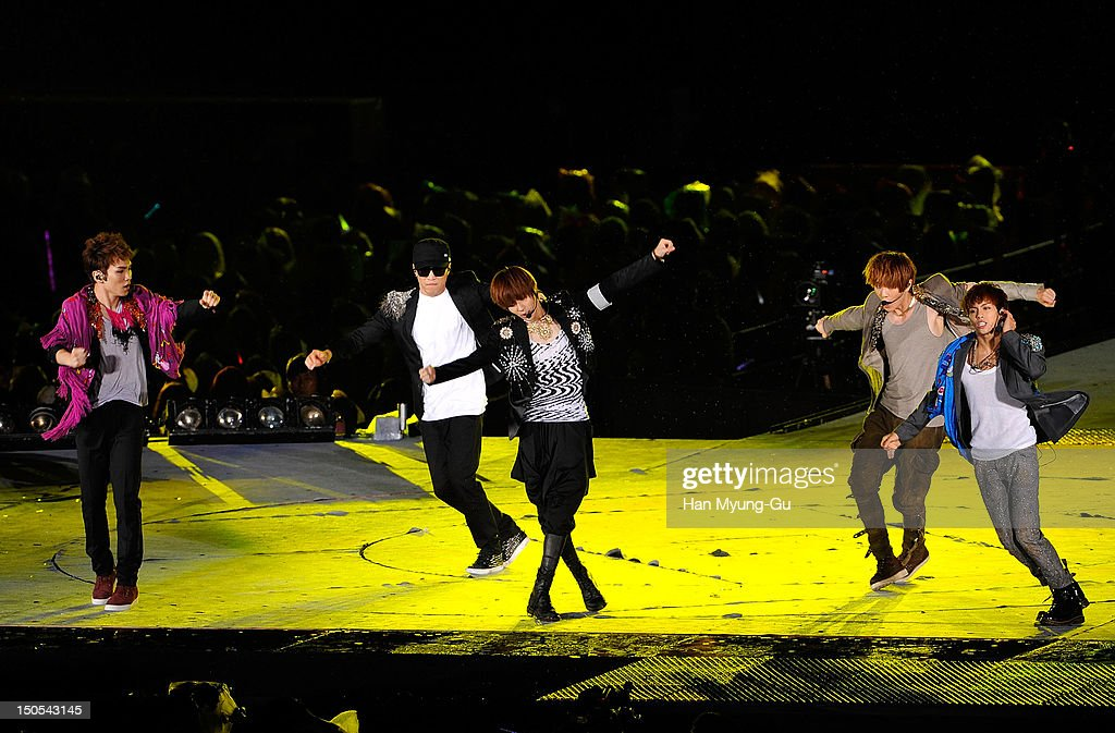 Members of South Korean boy band SHINee perform onstage during the SMTown Live World Tour III on August 18, 2012 in Seoul, South Korea.