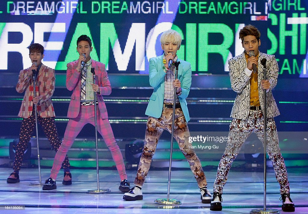 Members of South Korean boy band SHINee perform onstage during the MBC Music 'Show Champion' at Uniqlo-AX Hall on March 20, 2013 in Seoul, South Korea.