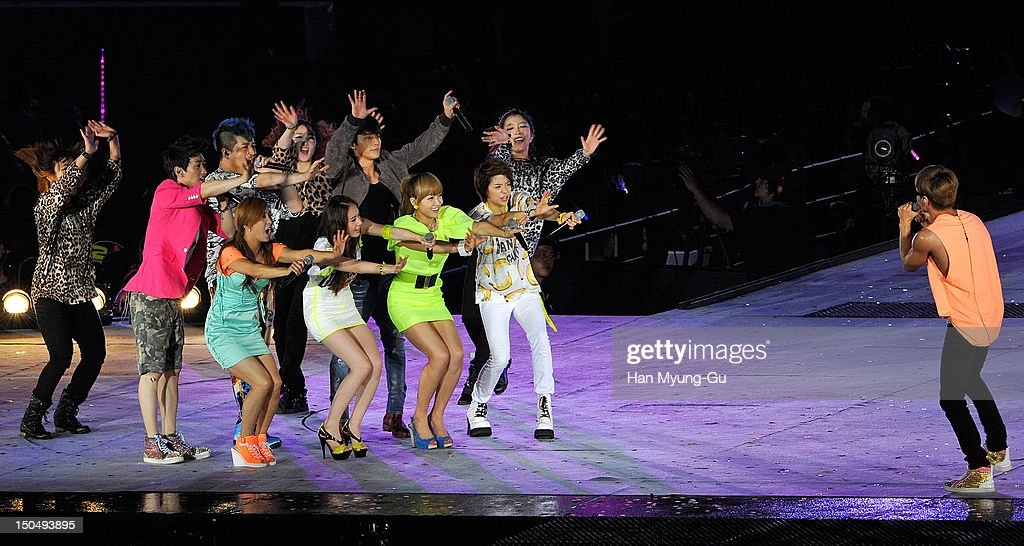 Members of South Korean boy band Super Junior and members of girl group f(x) perform onstage during the SMTown Live World Tour III on August 18, 2012 in Seoul, South Korea.