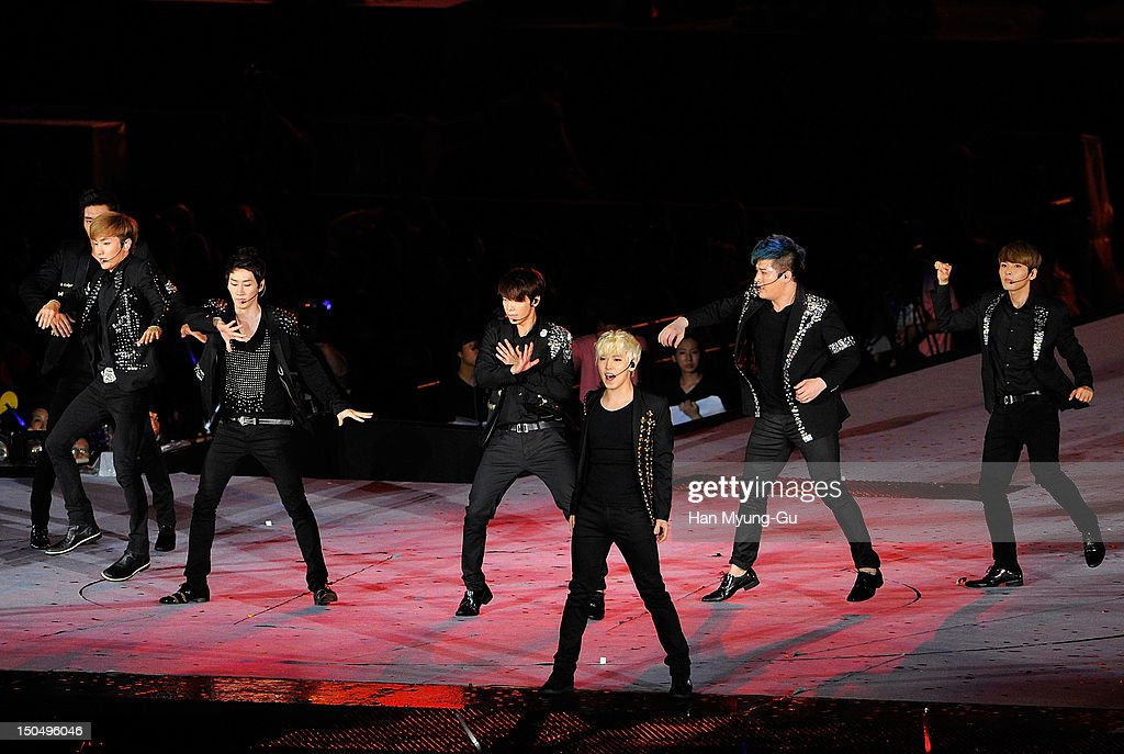 Members of South Korean boy band Super Junior perform onstage during the SMTown Live World Tour III on August 18, 2012 in Seoul, South Korea.