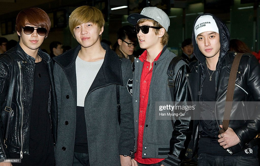 Members of South Korean boy band U-Kiss are seen at Incheon International Airport on January 18, 2013 in Incheon, South Korea.