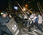 Members of South Korean Farmers protest during an antiWTO rally on November 13 2004 in Seoul South Korea 15000 South Korean farmers marched through...