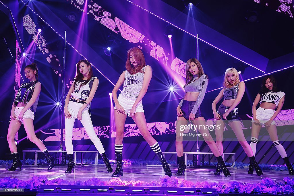 Members of South Korean girl group After School perform onstage during the Mnet 'M CountDown' at CJ E&M Center on June 20, 2013 in Seoul, South Korea.